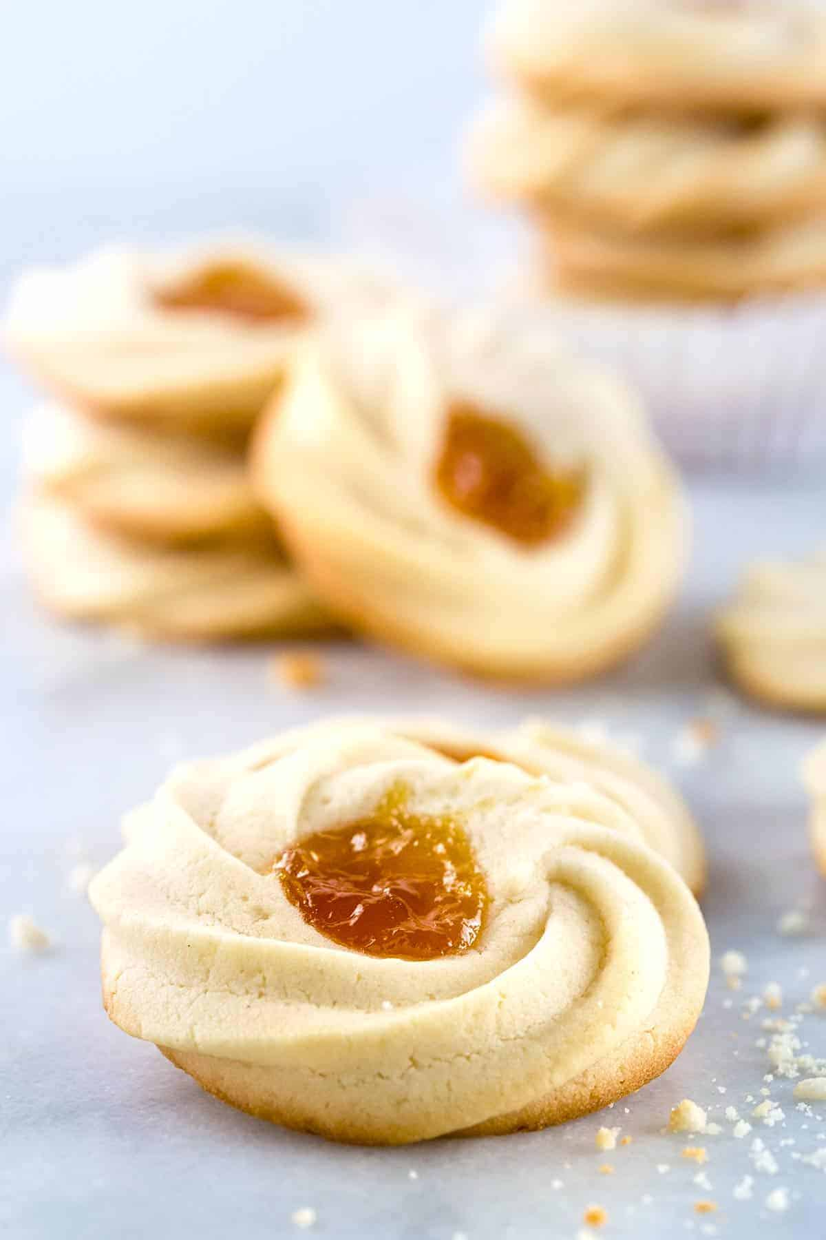 Apricot Spritz Cookie - Elegant sweets that delicately crumble in the mouth for instant bliss. The buttery cookies can be filled with any special fruit jam of your choice! | jessicagavin.com