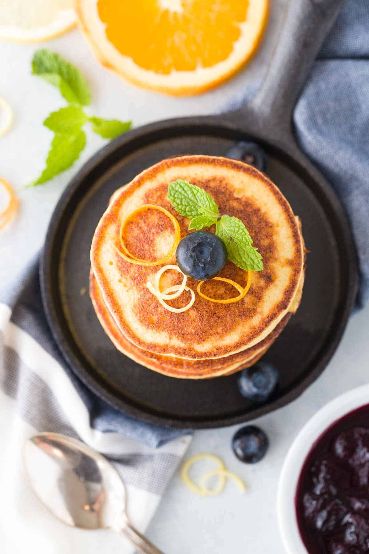 Stack of ricotta pancakes on a skillet