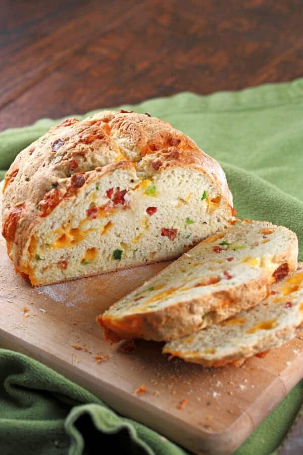 Irish Cheddar and Bacon Soda Bread - A twist on a traditional recipe, this loaf is packed with melted cheese, savory bacon and scallions. | jessicagavin.com