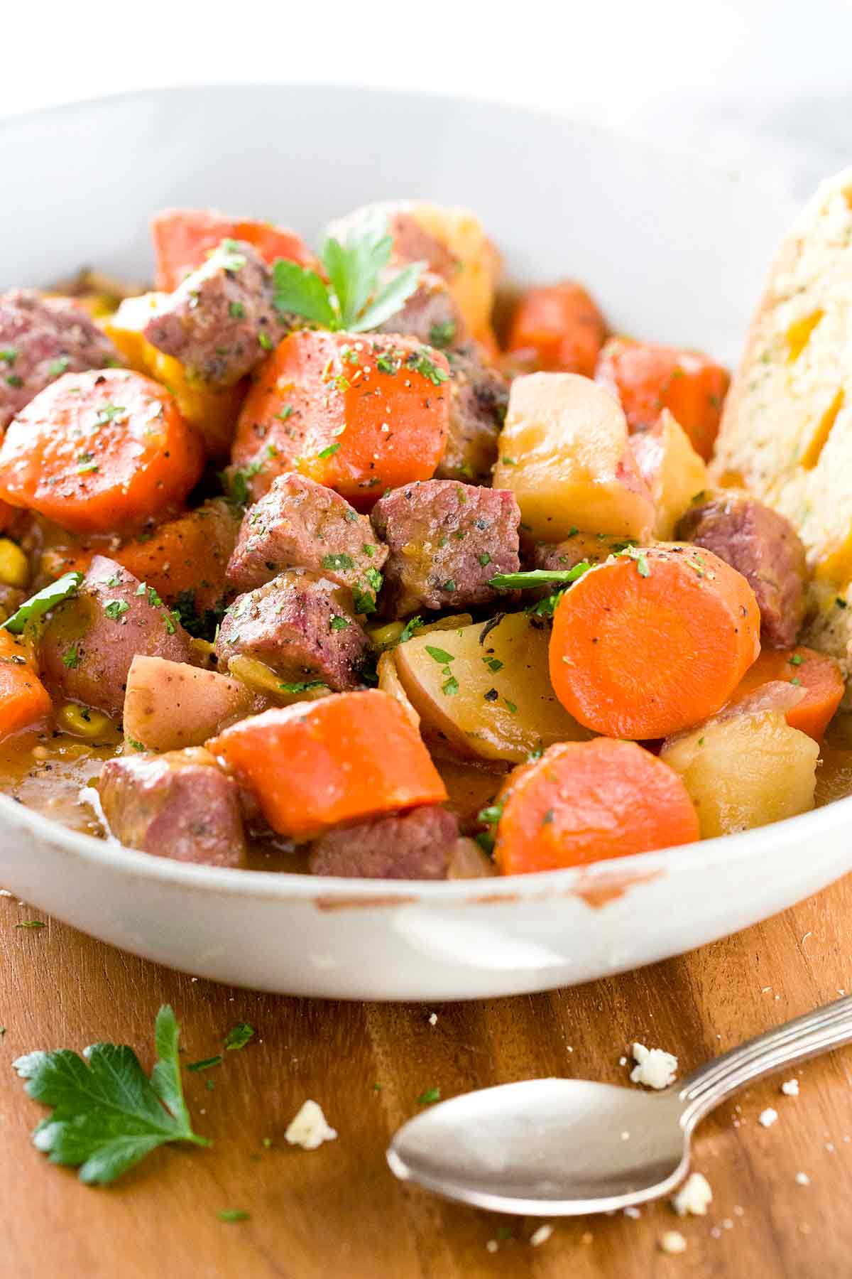 Corned beef and chunks of potatoes and carrots in a bowl