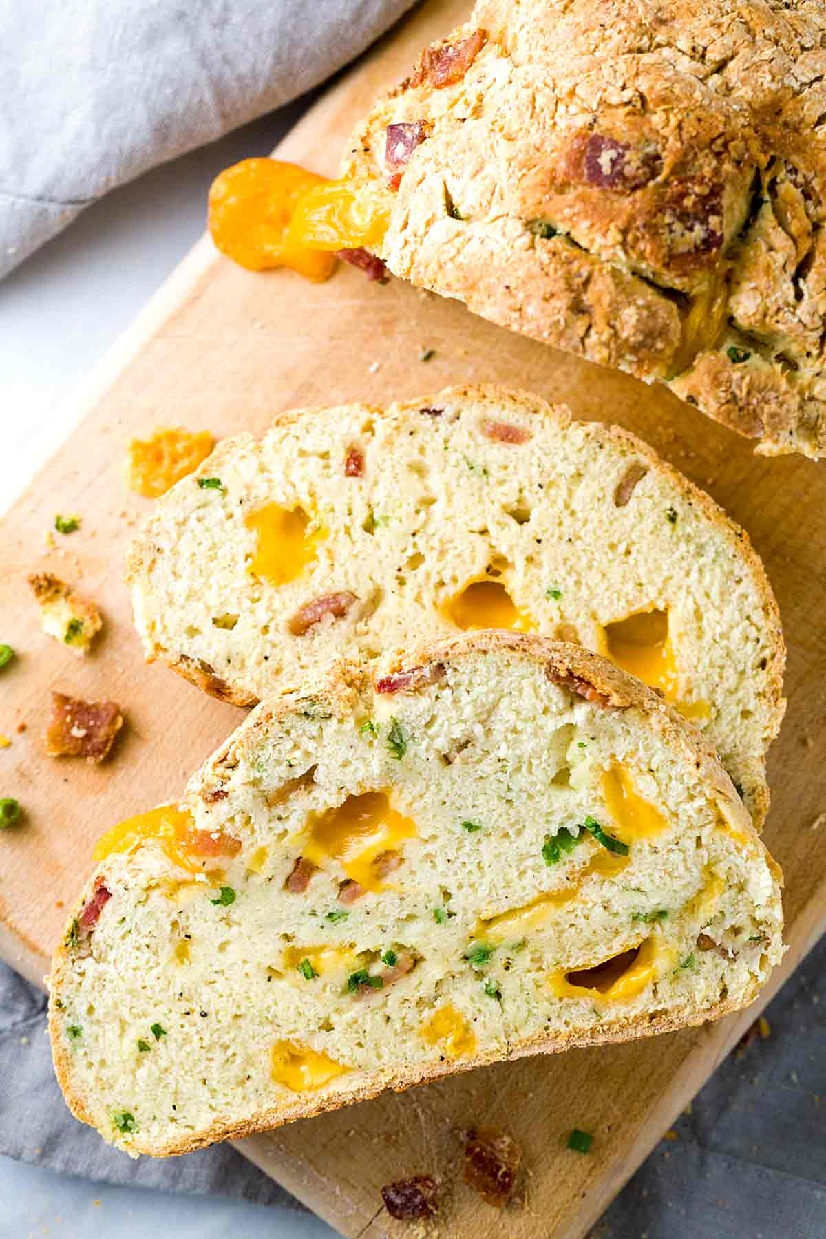 Irish Cheddar and Bacon Soda Bread - A twist on a traditional recipe, this loaf is packed with melted cheese, savory bacon and scallions.   jessicagavin.com