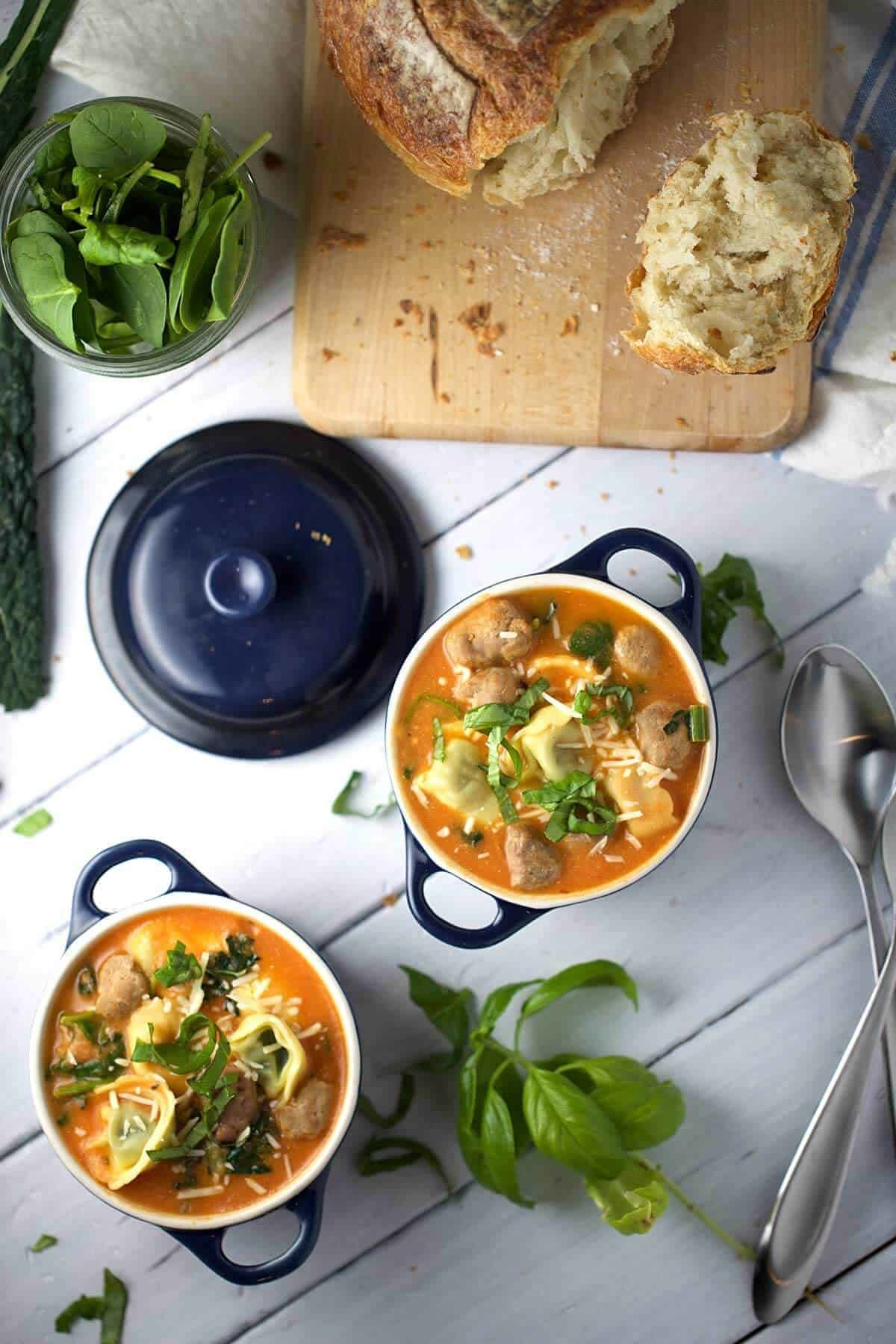 Tuscan tomato tortellini soup with Italian sausage - One of my favorite recipes, a hearty meal served with cheese and spinach pasta. | jessicagavin.com