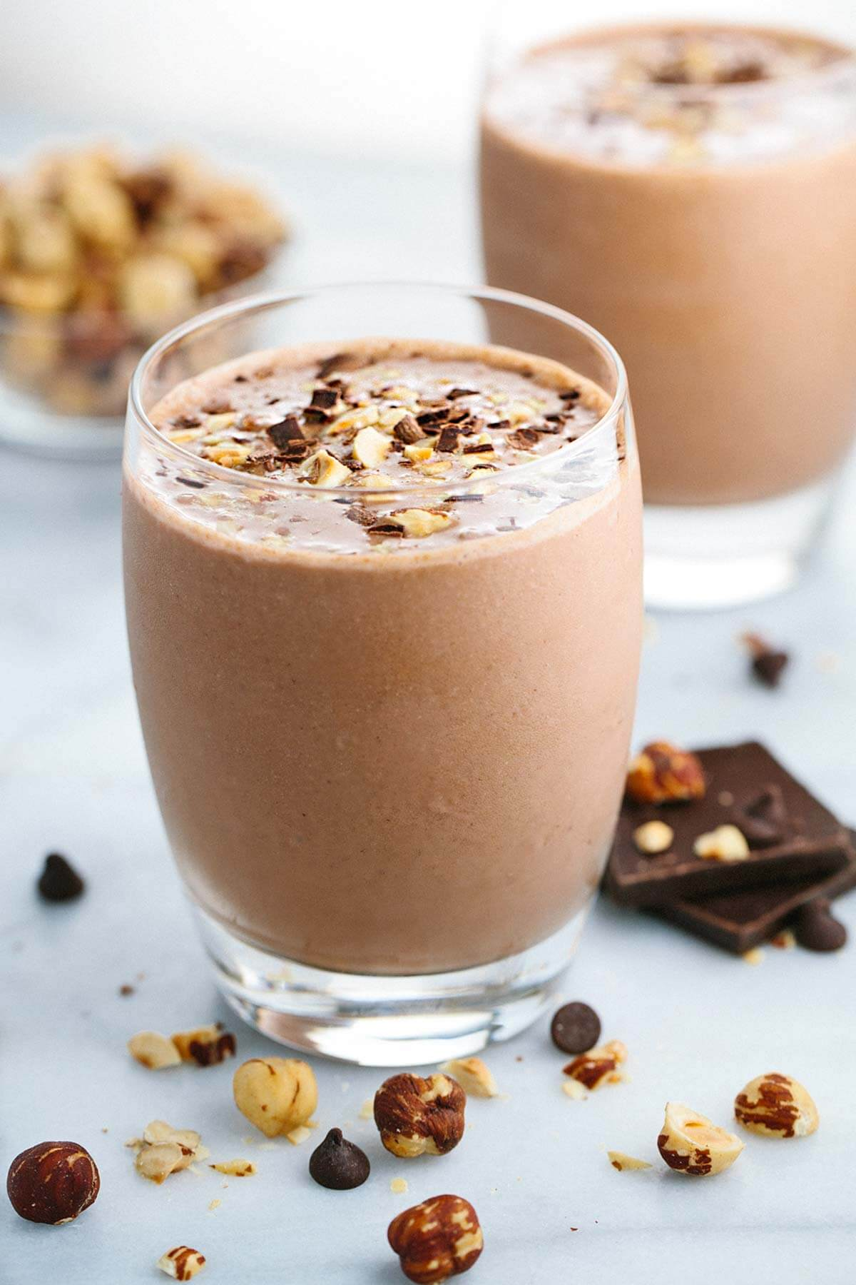 Chocolate Hazelnut Smoothie with Bananas - This creamy blended drink recipe is the perfect way to indulge without the guilt. Roasted hazelnuts, cocoa, and banana make each sip satisfying! | jessicagavin.com