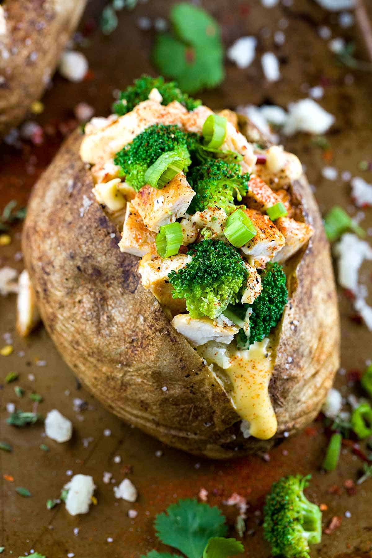 Chicken Broccoli Stuffed Baked Potato with Cheese Sauce - A balanced meal of protein, vegetables and carbohydrates all in one crispy roasted potato! | jessicagavin.com