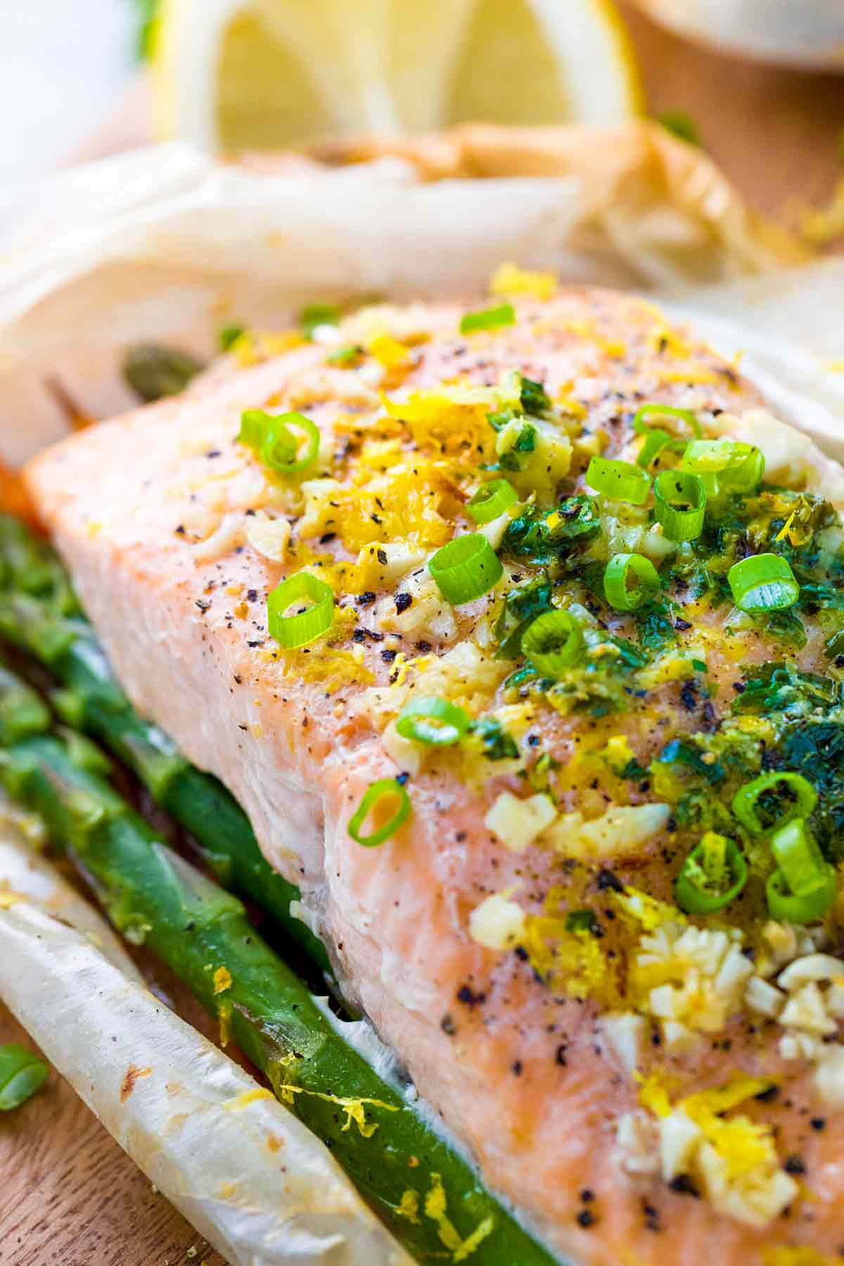 The melted compound butter seasons the fish and vegetables
