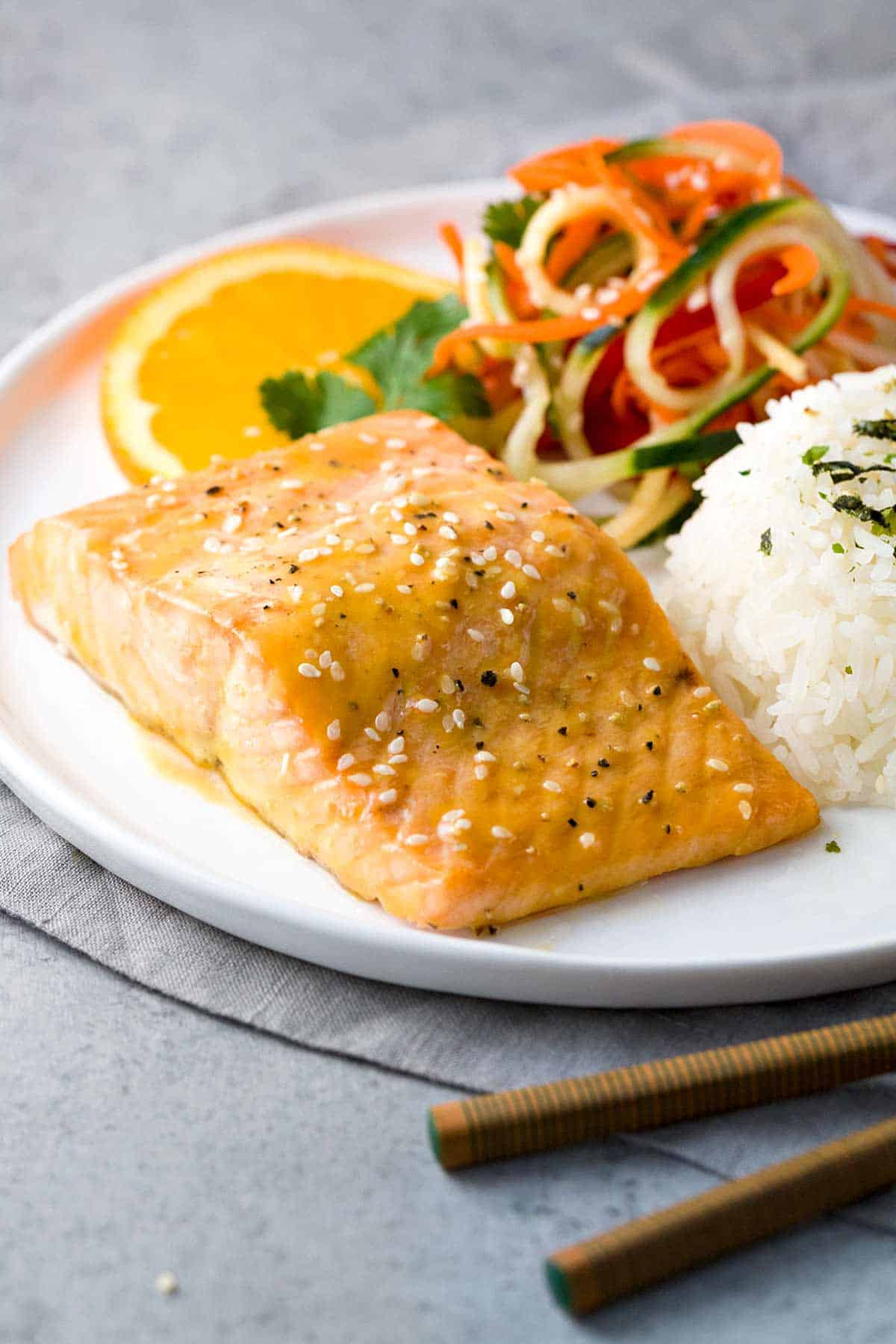 Pan Roasted Citrus-Soy Glazed Salmon - A quick and flavorful Asian-inspired recipe combining healthy protein and omega-3 fatty acids. Served with a crunchy and refreshing cucumber and vegetable salad. | jessicagavin.com