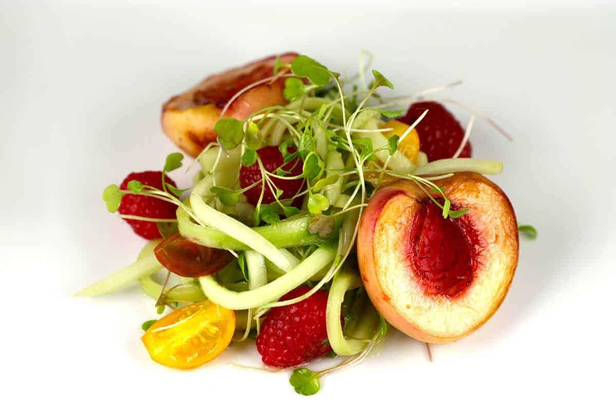 Fresh and healthy raspberry and roasted peach salad recipe   jessicagavin.com