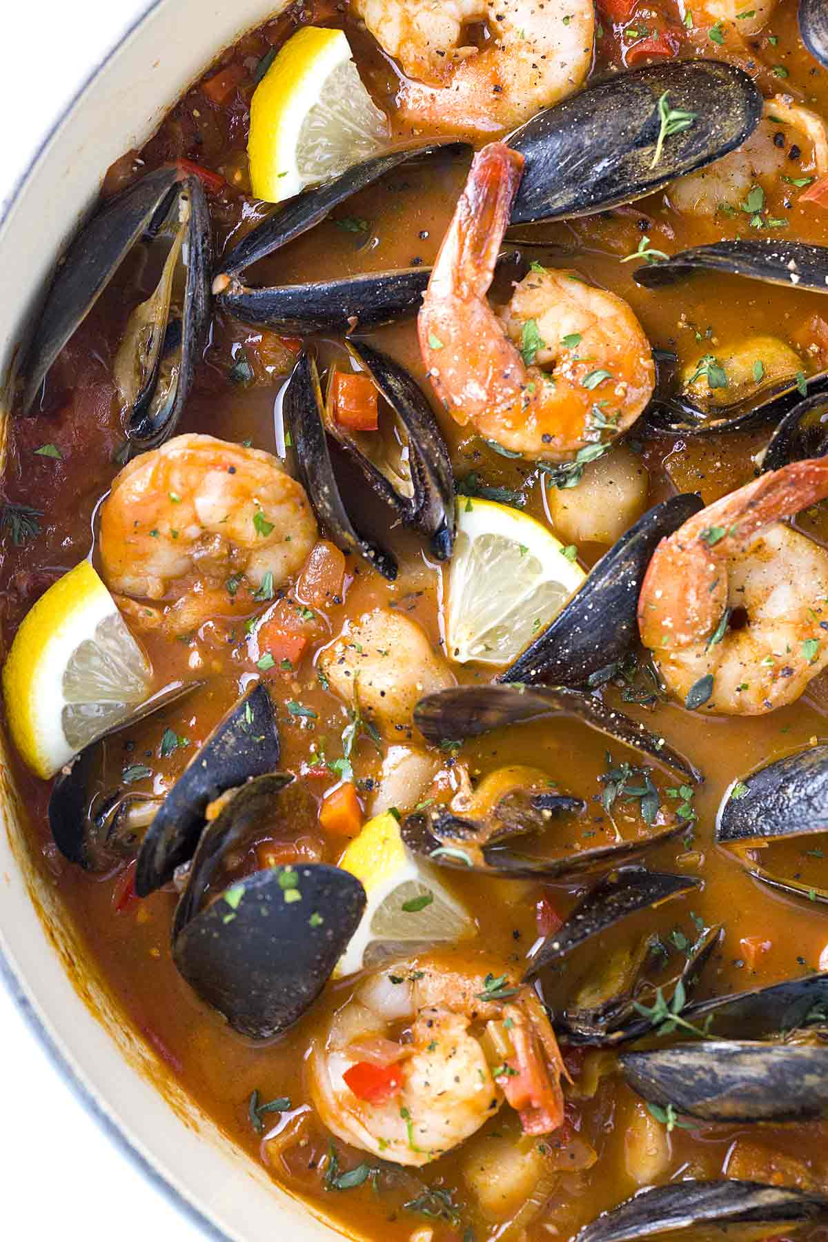 San Francisco Style Seafood Cioppino - A pot of fresh mussels, shrimp, and scallops simmered in a savory tomato and red wine broth. Served with homemade crunchy croutons! | jessicagavin.com