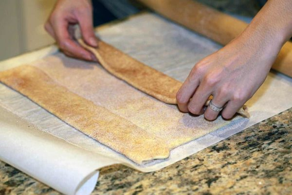 folding the puff pastry over sugar