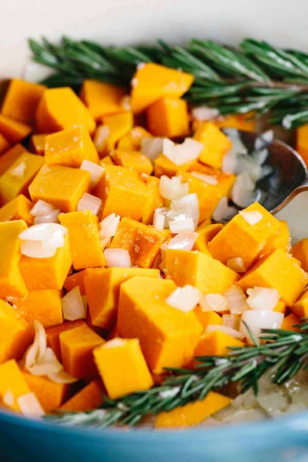 Cubes of butternut squash cooking in a pan