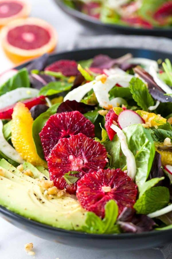 Blood Orange and Fennel Salad - A healthy blend of greens combined with avocado, mint, radish, parmesan cheese and walnuts topped with a citrus vinaigrette. | jessicagavin.com