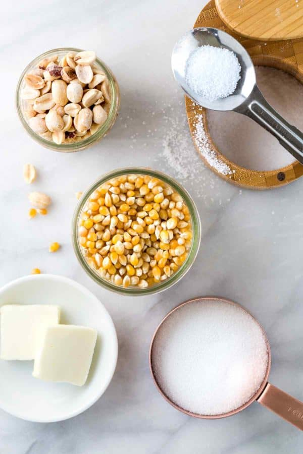 Individual portions of corn kernels, peanuts, salt, sugar, and butter.