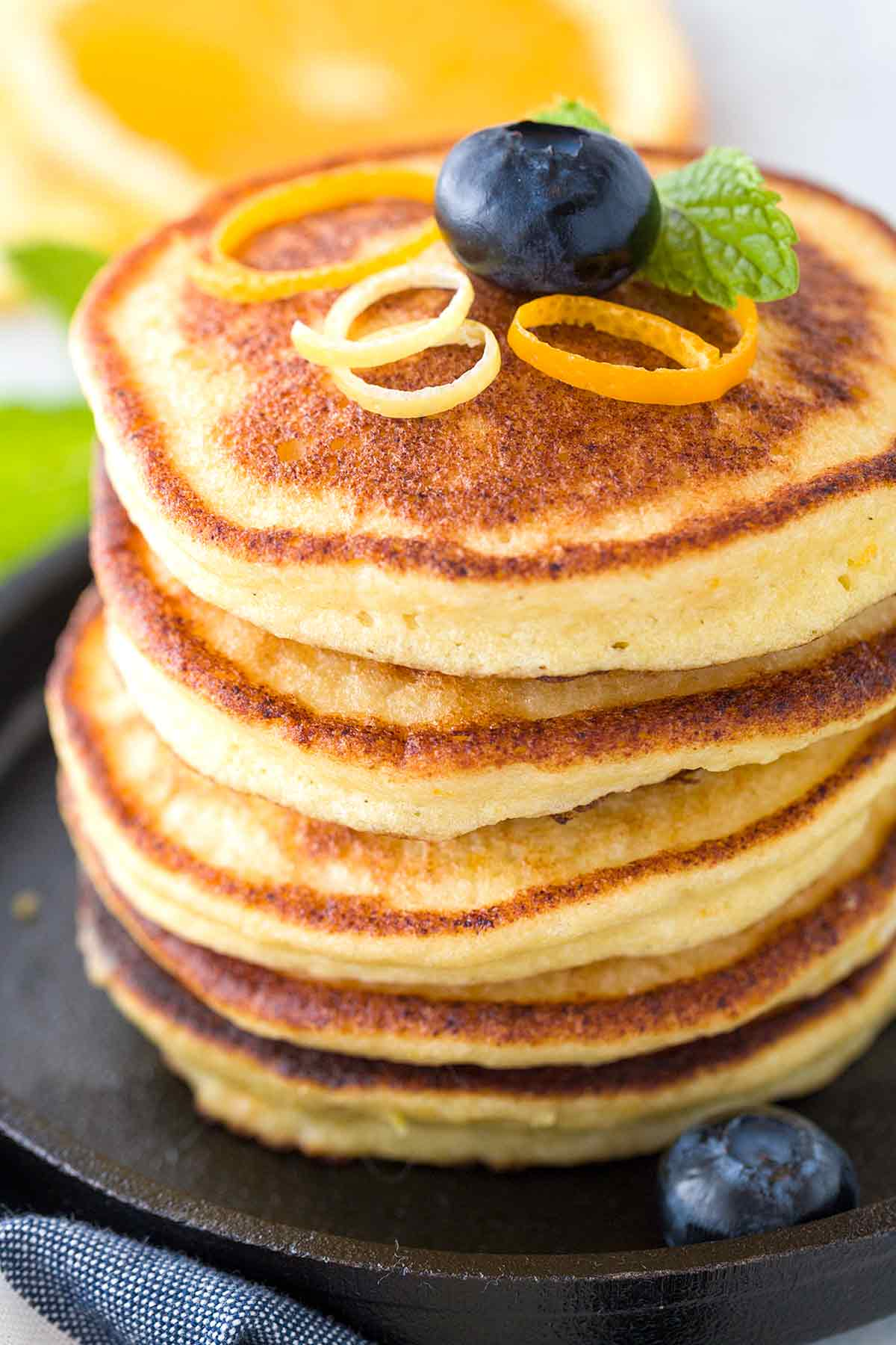 Big stack of thick ricotta pancakes with blueberries