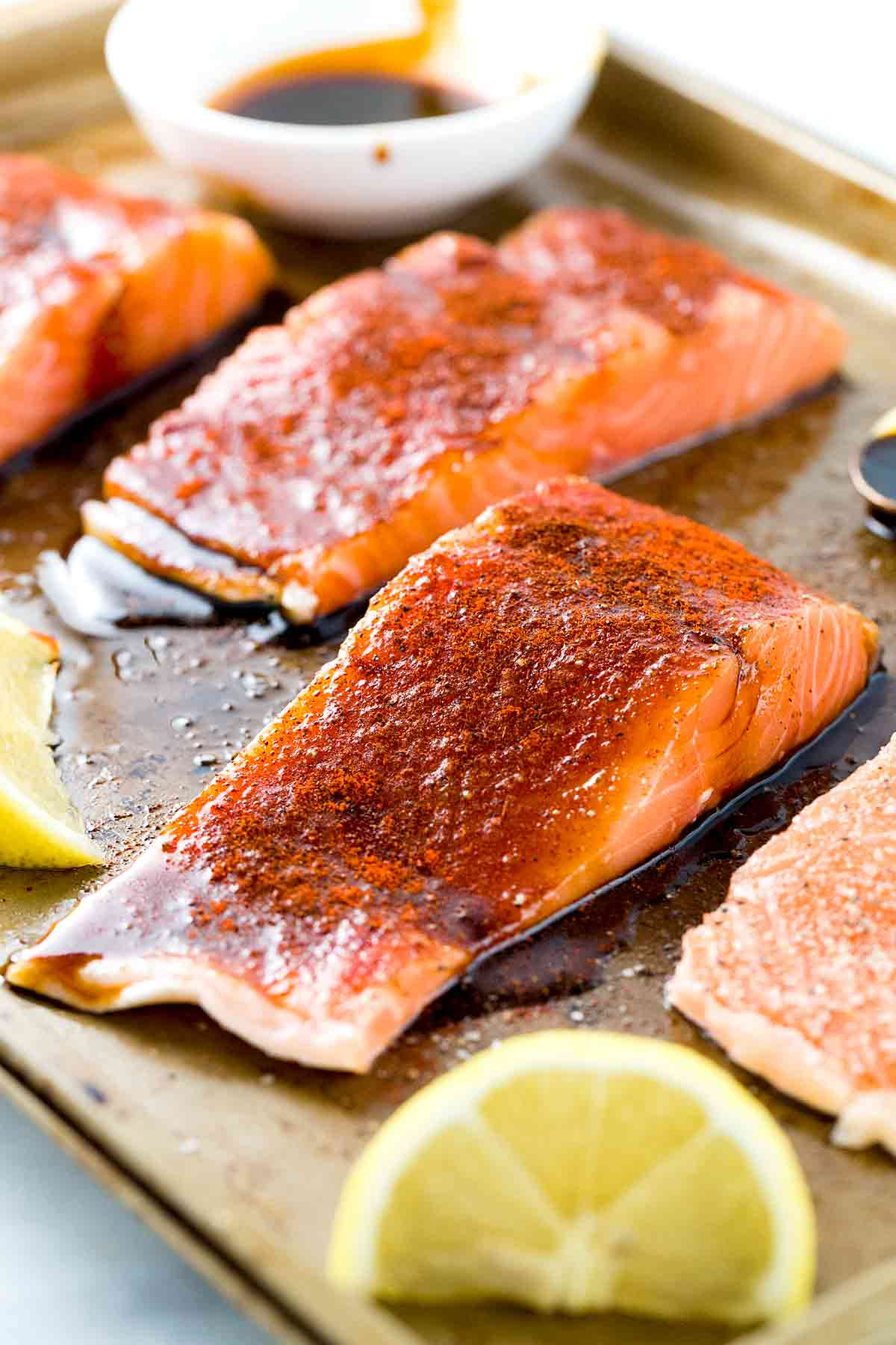 Salmon fillets on sheet pan with dried spices