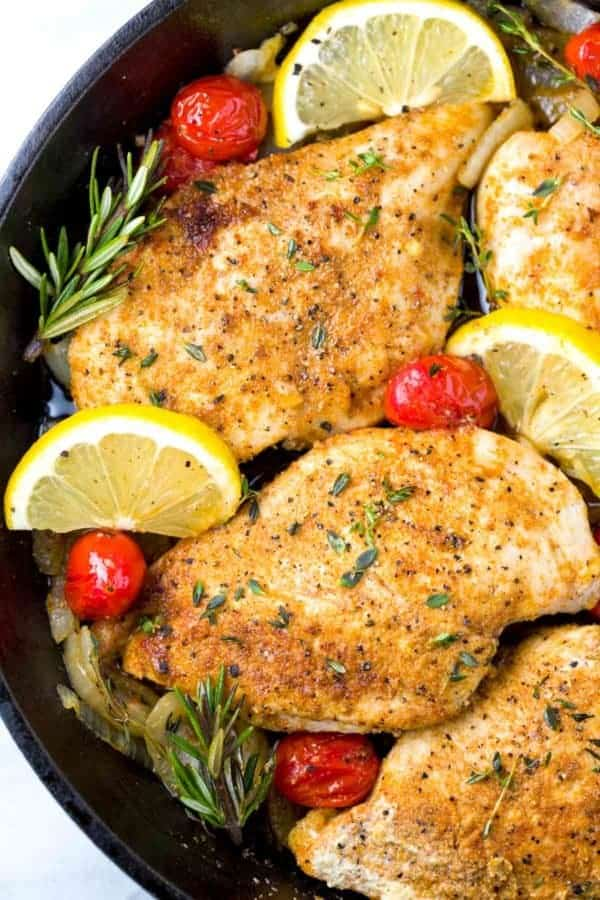 Lemon slices and blistered tomatoes with seasoned chicken