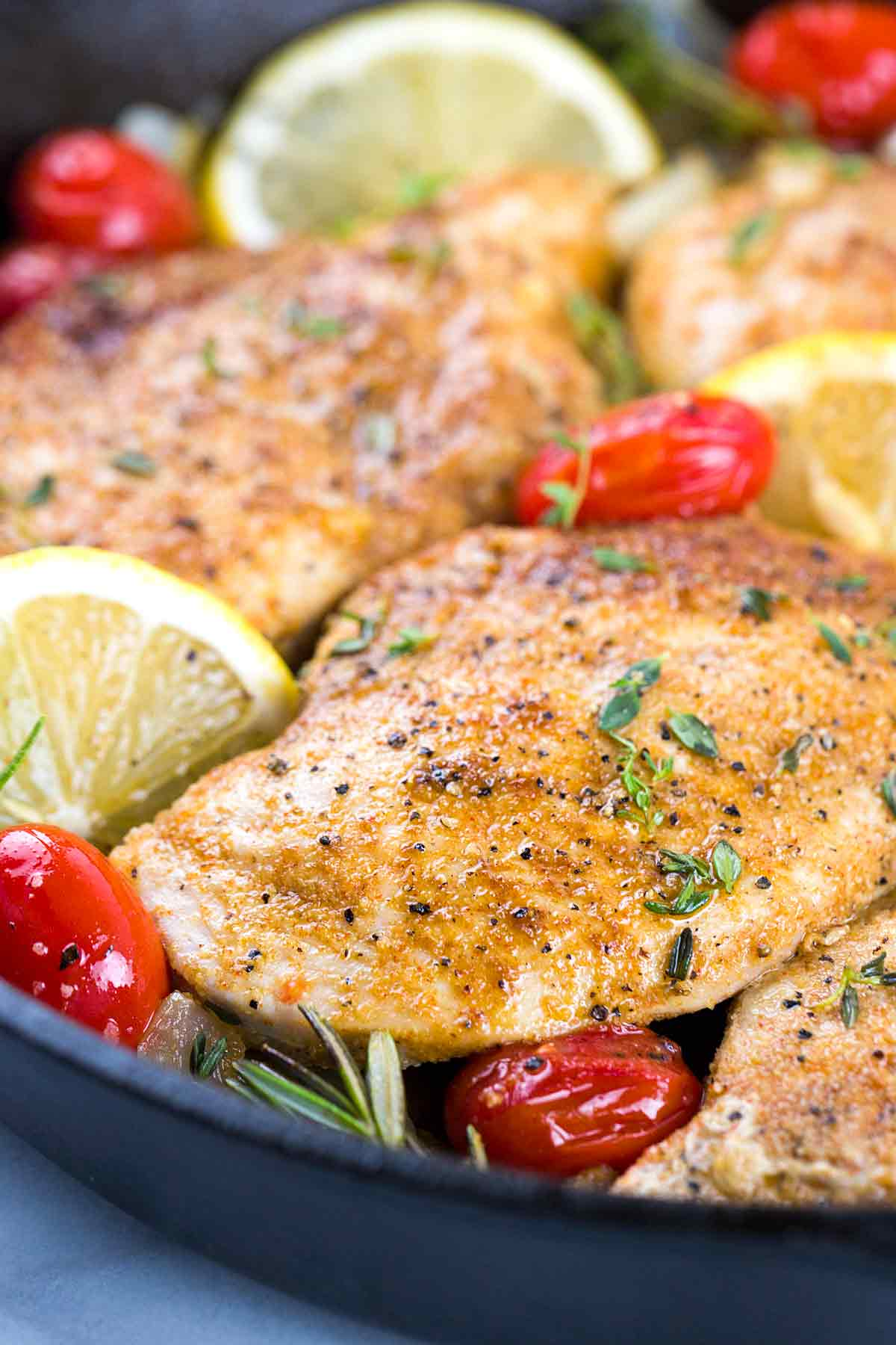 Moroccan lemon chicken cooking in a skillet