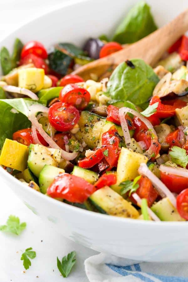 Summer Succotash Salad - All of the season's most tasty vegetables all in one bowl! This recipe combines fresh grilled vegetables with a tangy citrus dressing. | jessicagavin.com