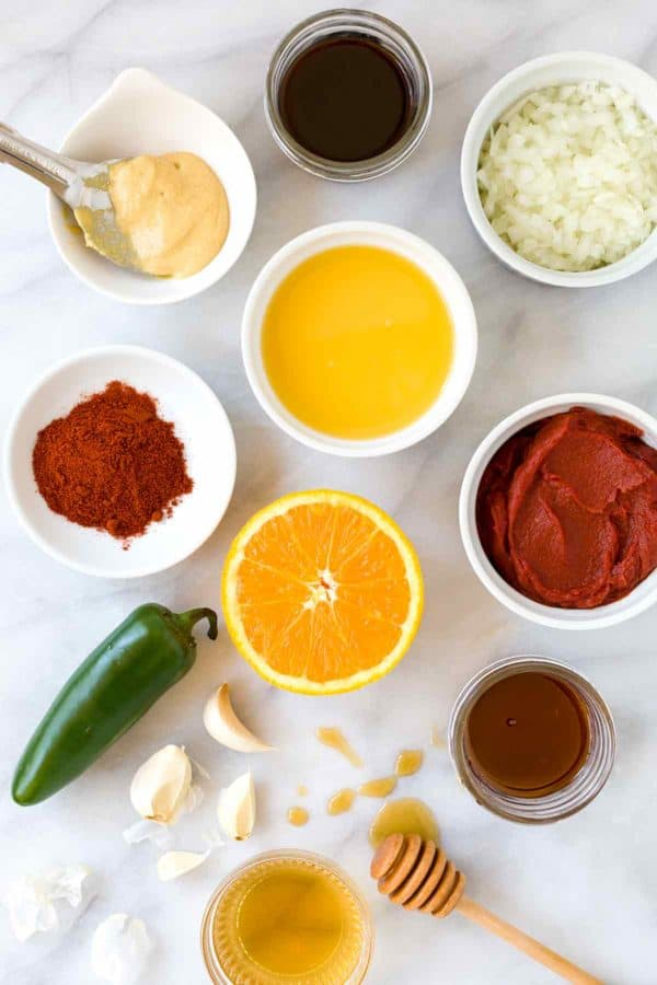 Homemade barbecue sauce Ingredients portioned in small jars and placed on a marble surface