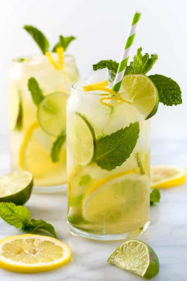 Two glasses of iced green tea with lemon and lime slices