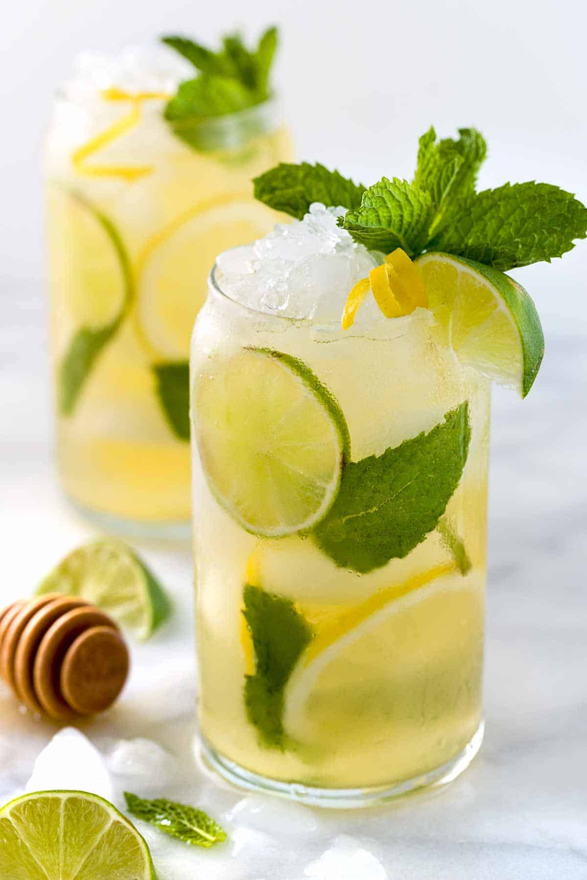 Iced green tea with lemon, lime, and fresh mint is a refreshing and revitalizing beverage for those warm days. Each glass is naturally sweetened with honey and packed with antioxidants.