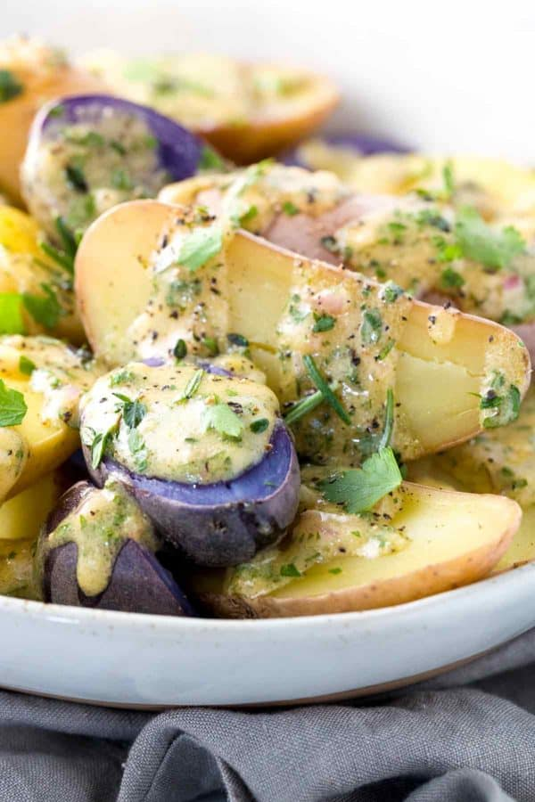 Purple and gold fingerling potatoes with homemade herb vinaigrette dressing