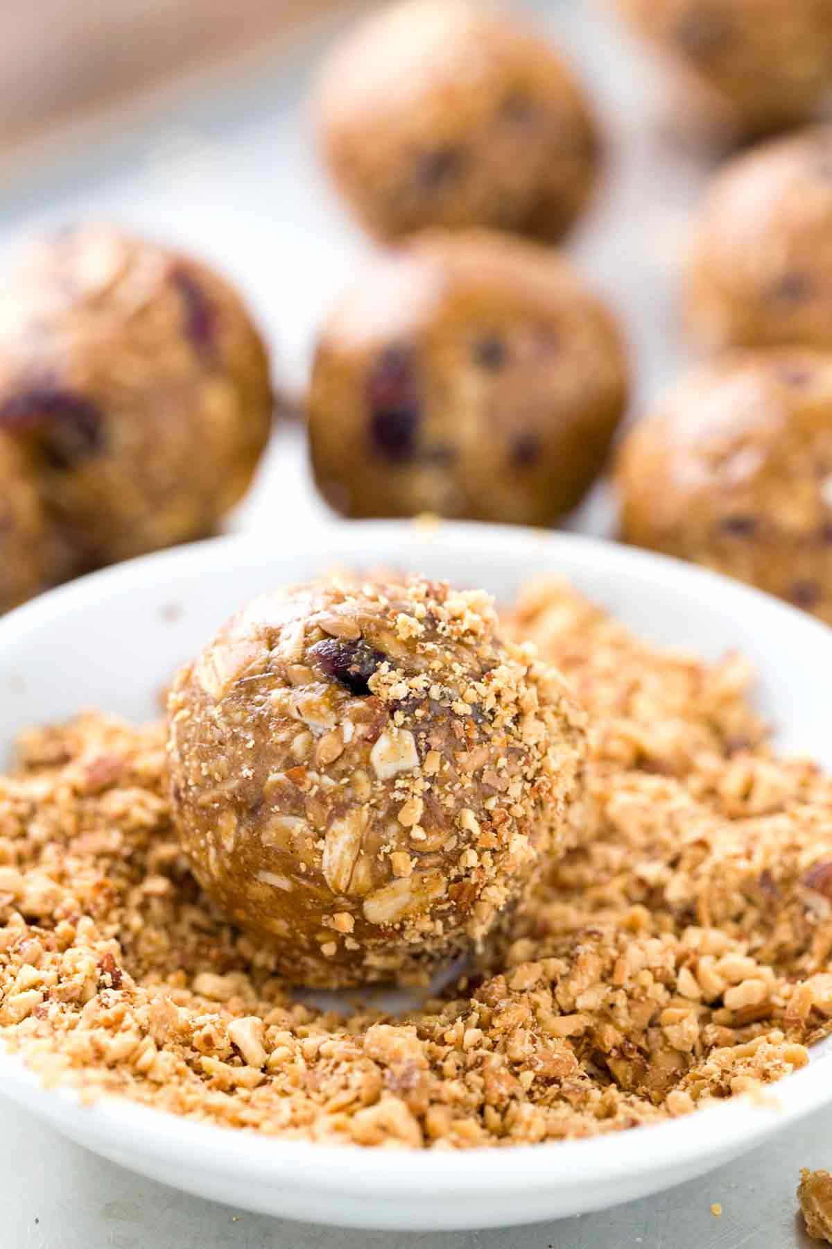 Roll and coat the outside of the energy bites in nuts or oats