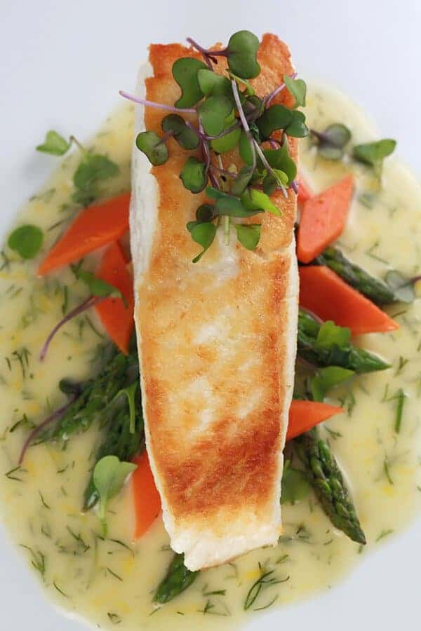 Pan Seared Halibut with Lemon Dill Sauce - Tender golden filets are sautéed and served with a luscious French lemon dill beurre blanc sauce | jessicagavin.com