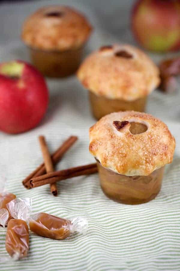 jars of miniature apple. pies with caramel sauce