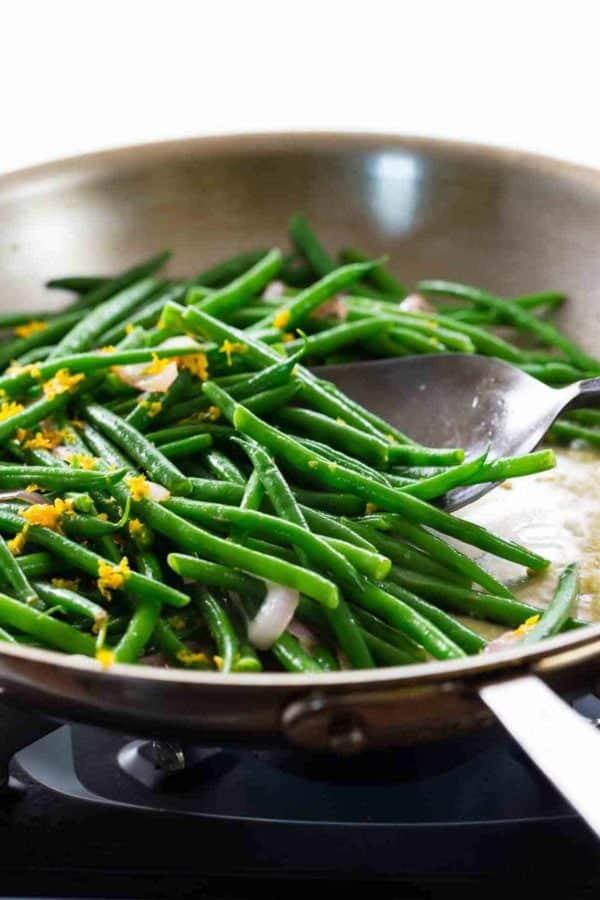 green beans sautéing in a skillet