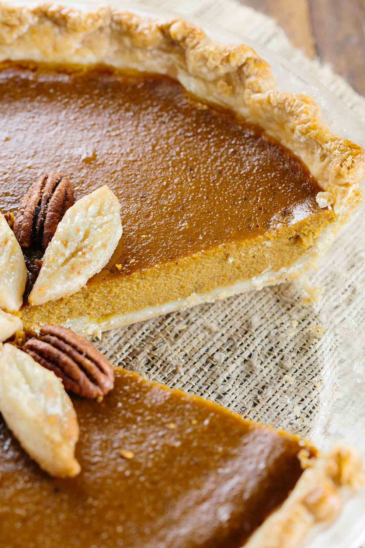 Pumpkin pie with a slice removed