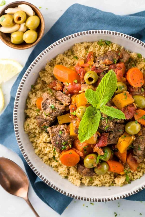 Moroccan lamb stew is a hearty Mediterranean dish packed with sweet and savory flavors. Each serving is loaded with fragrant braised vegetables and couscous for a complete meal!