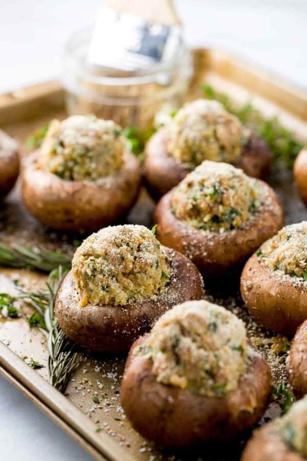 Brush of olive oil on the mushroom tops before baking