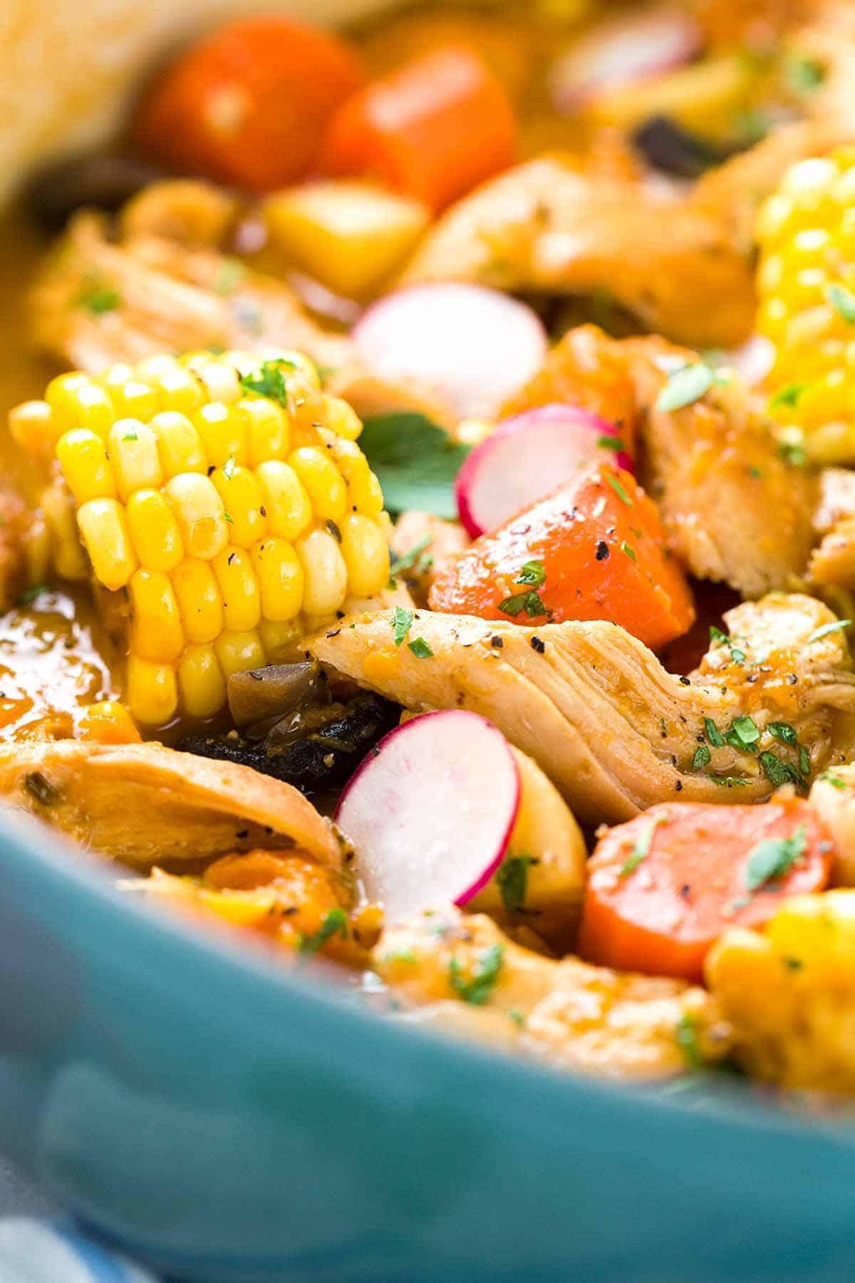 chicken stew inside a dutch oven pot