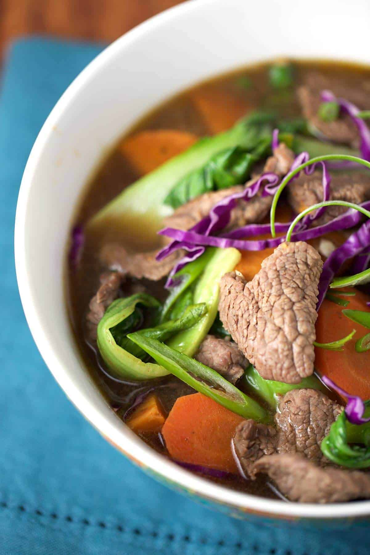 Chinese Five Spice Beef Soup with Bok Choy - a flavor-packed recipe with carrots, sweet potato, bok choy and red cabbage make this soup healthy and filling! | jessicagavin.com