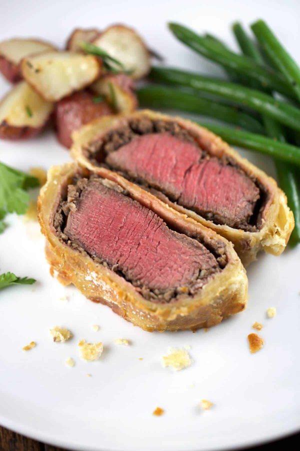 plated beef wellington sliced in half