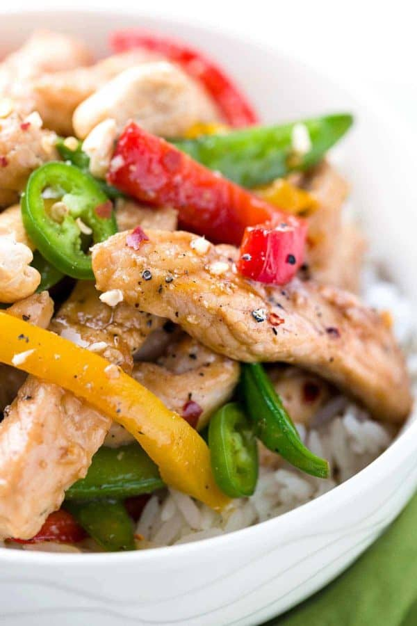 Close up of seasoned pork and vegetables on top of white rice