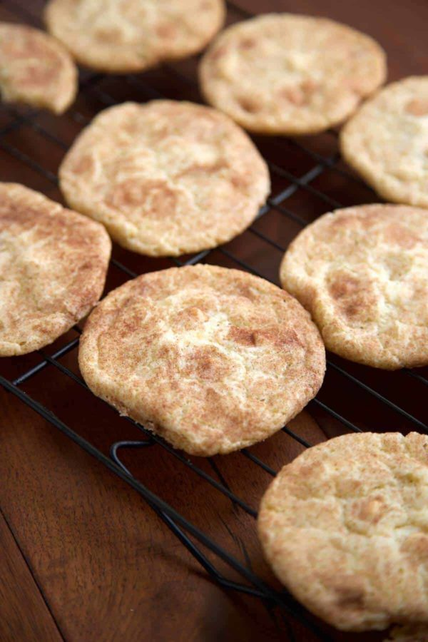 Snickerdoodle cookies cooling on a wire rack