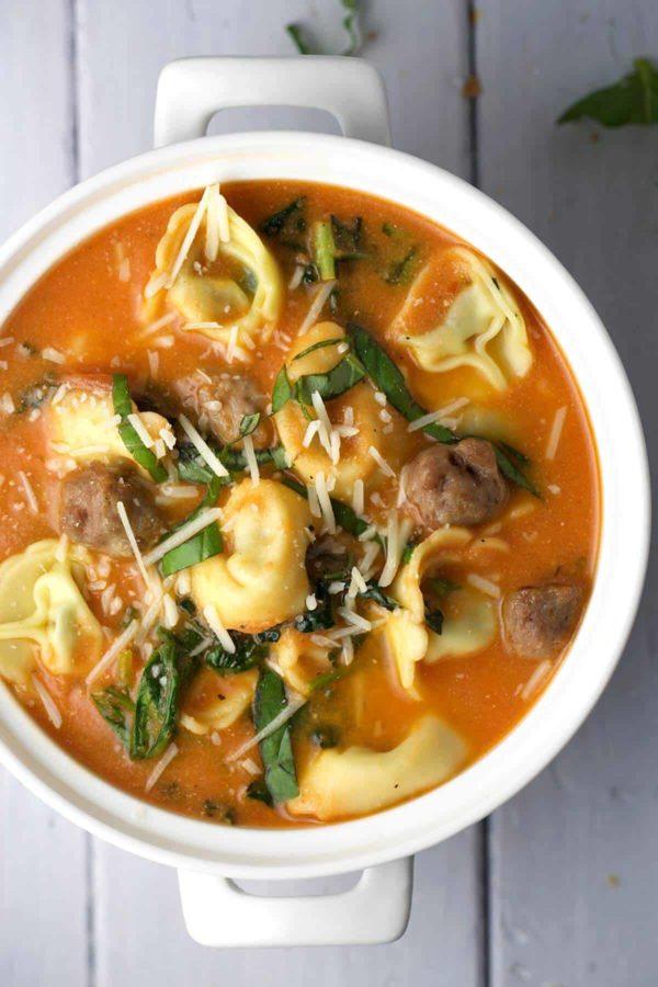 big white bowl Tuscan tomato tortellini soup with Italian sausage