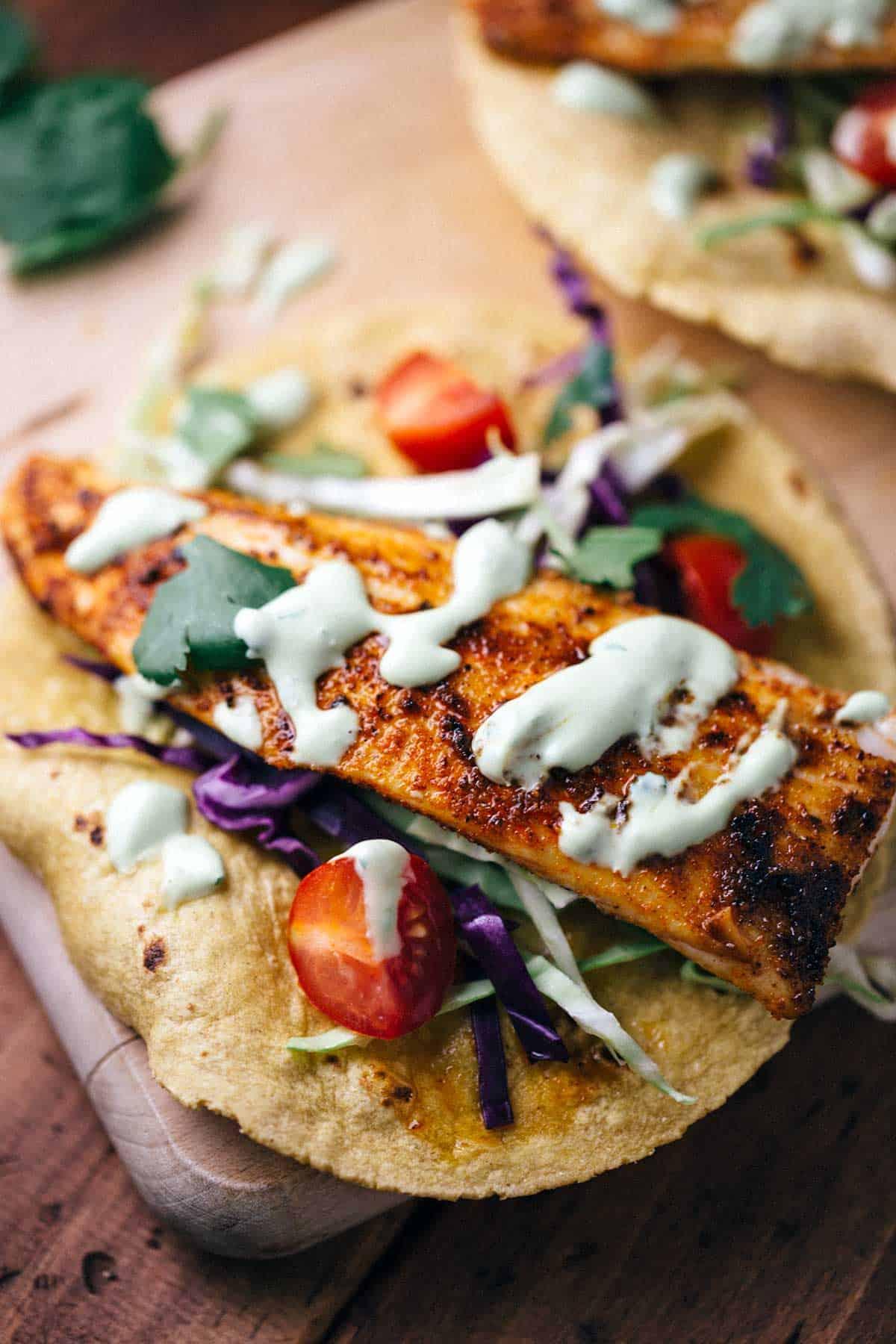Blackened mahi mahi fish tacos with avocado sauce for Recipe fish tacos
