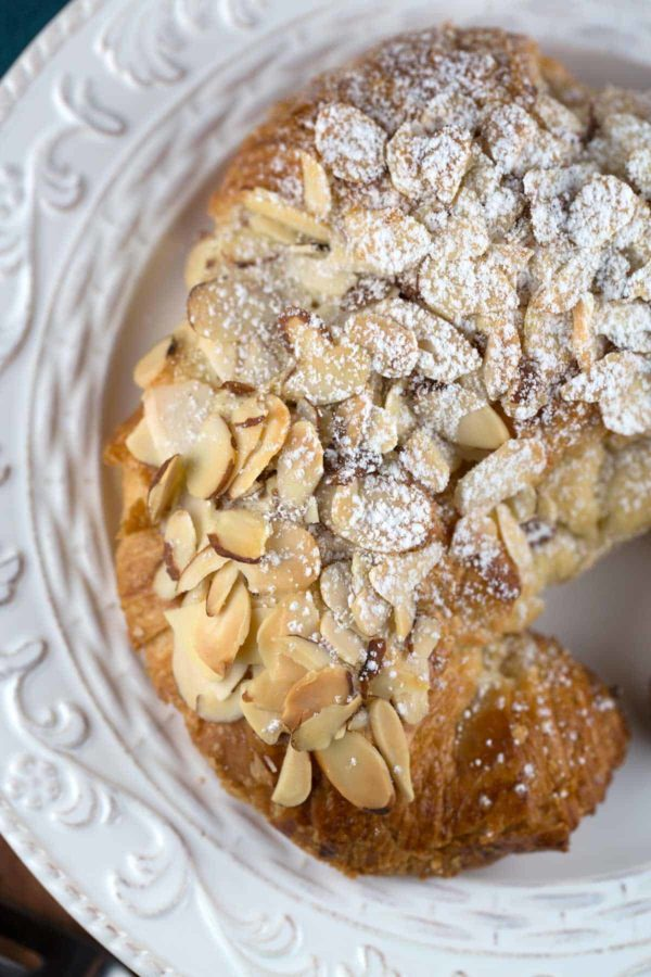 top down view of a plate with an almond croissant