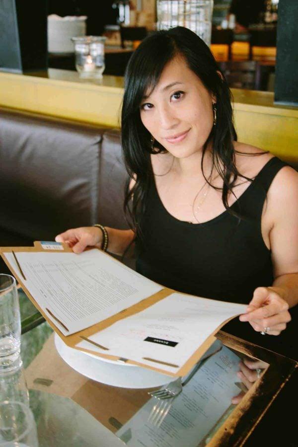 jessica looking at the menu inside ad hoc restaurant