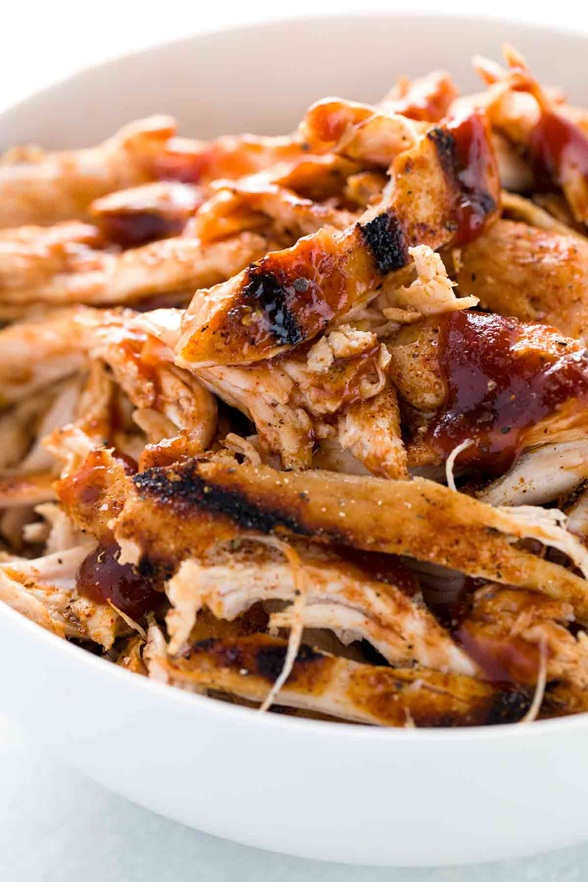 Shredded pieces of barbecued pull chicken mixed with bbq sauce