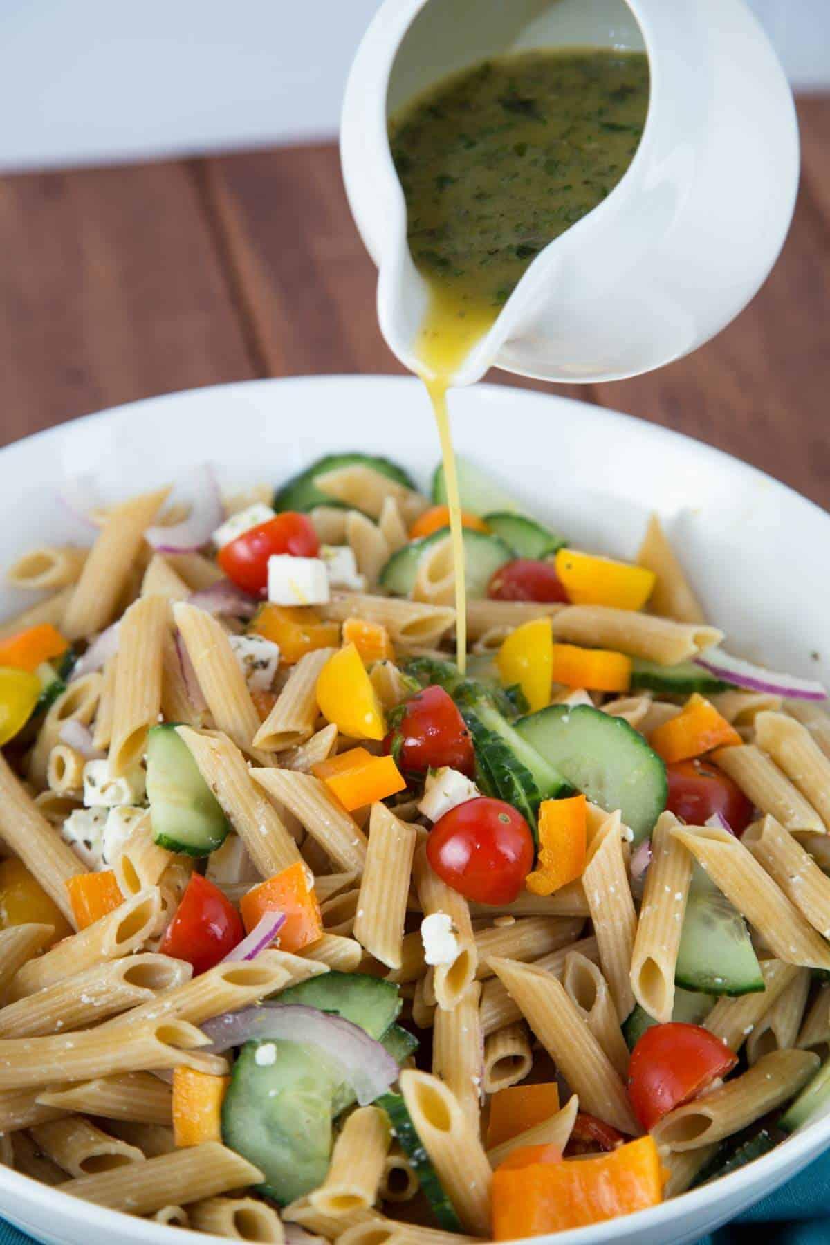 Mixing homemade dressing onto delicious pasta salad | jessicagavin.com