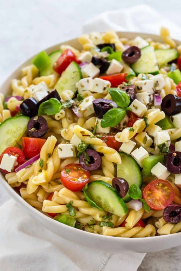 Greek pasta salad in a white bowl