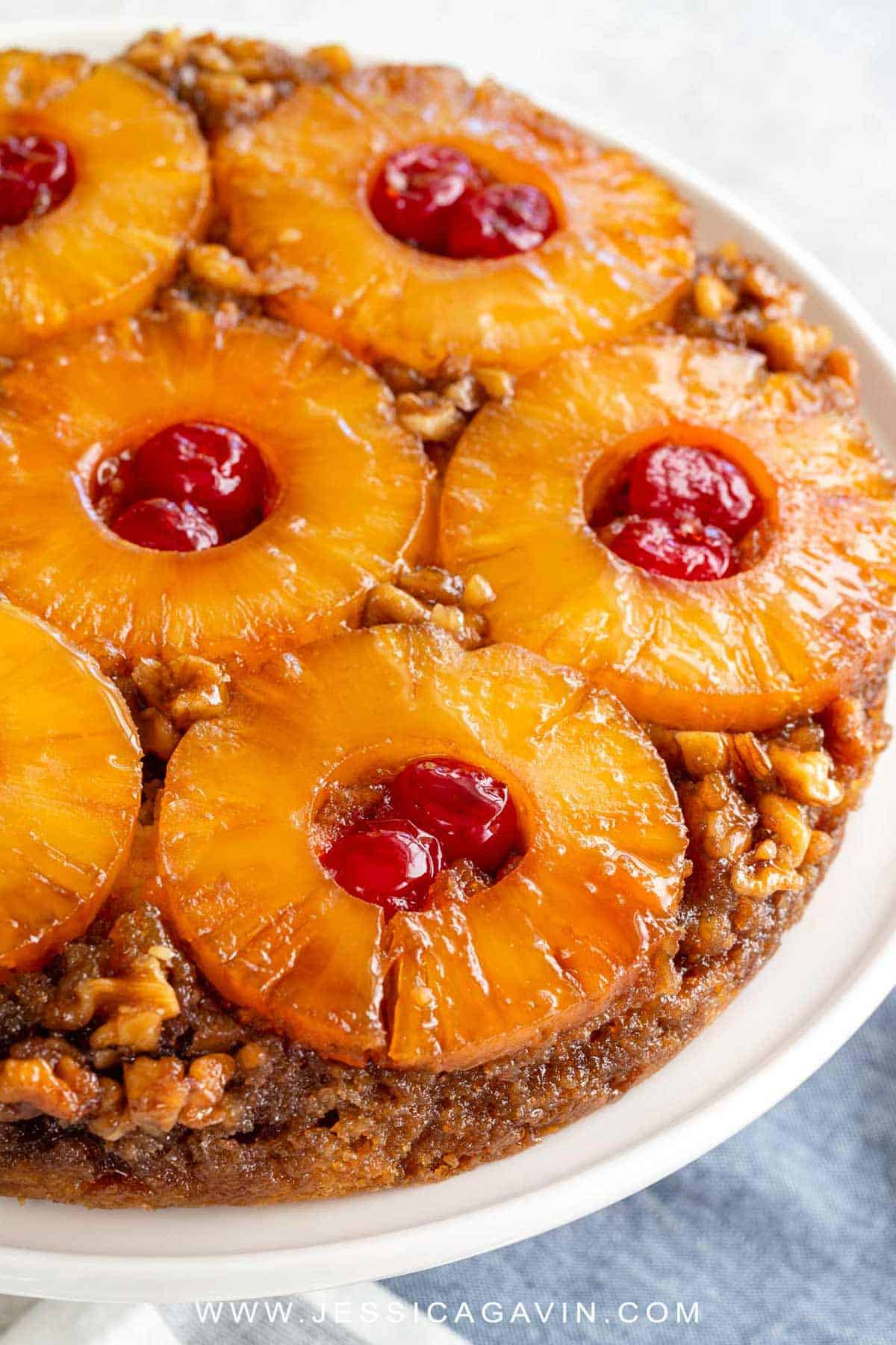 Classic pineapple upside-down cake made from scratch. Tender vanilla cake topped caramelized brown sugar, Maraschino cherries, walnuts, and pineapple rings. #cake #pineapple #dessert #party