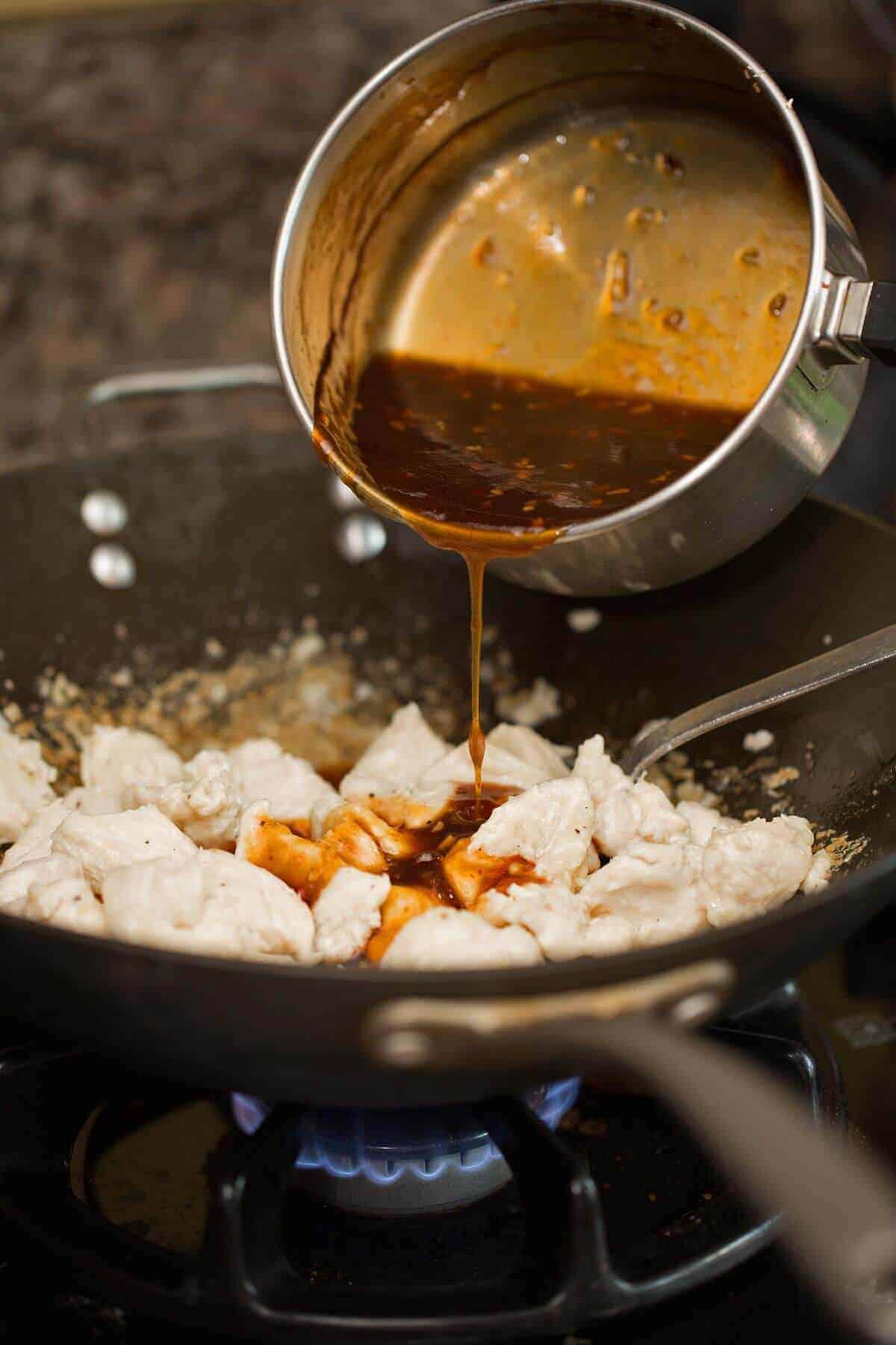 Sriracha sauce mixed with stir-fry chicken recipe