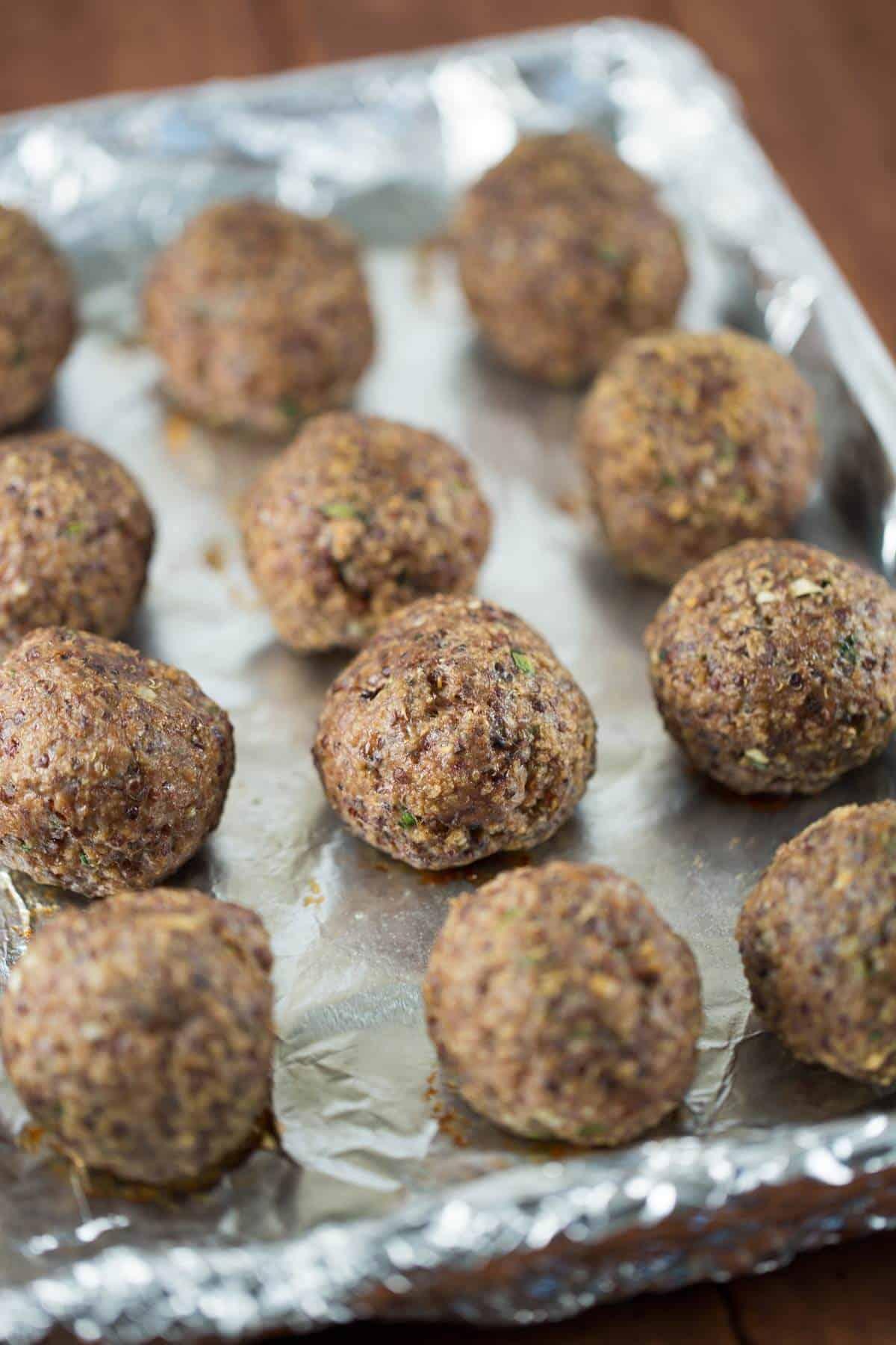 Baking tray of quinoa meatballs | jessicagavin.com