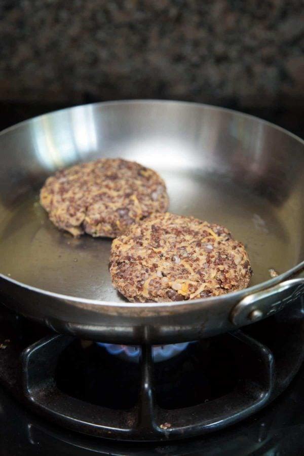 Cooking quinoa burger patties in a skillet