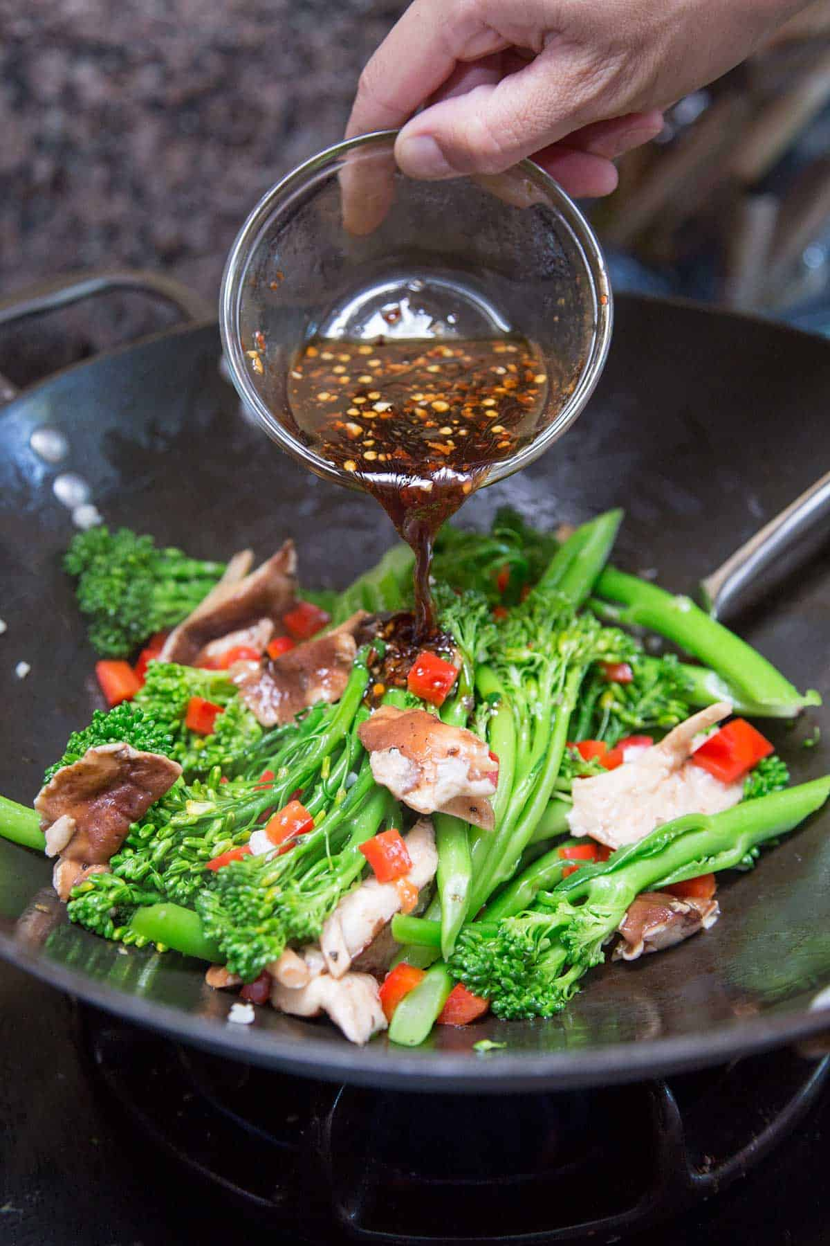 Sriracha hot chili sauce and red pepper flakes are infused into the broccolini | jessicagavin.com