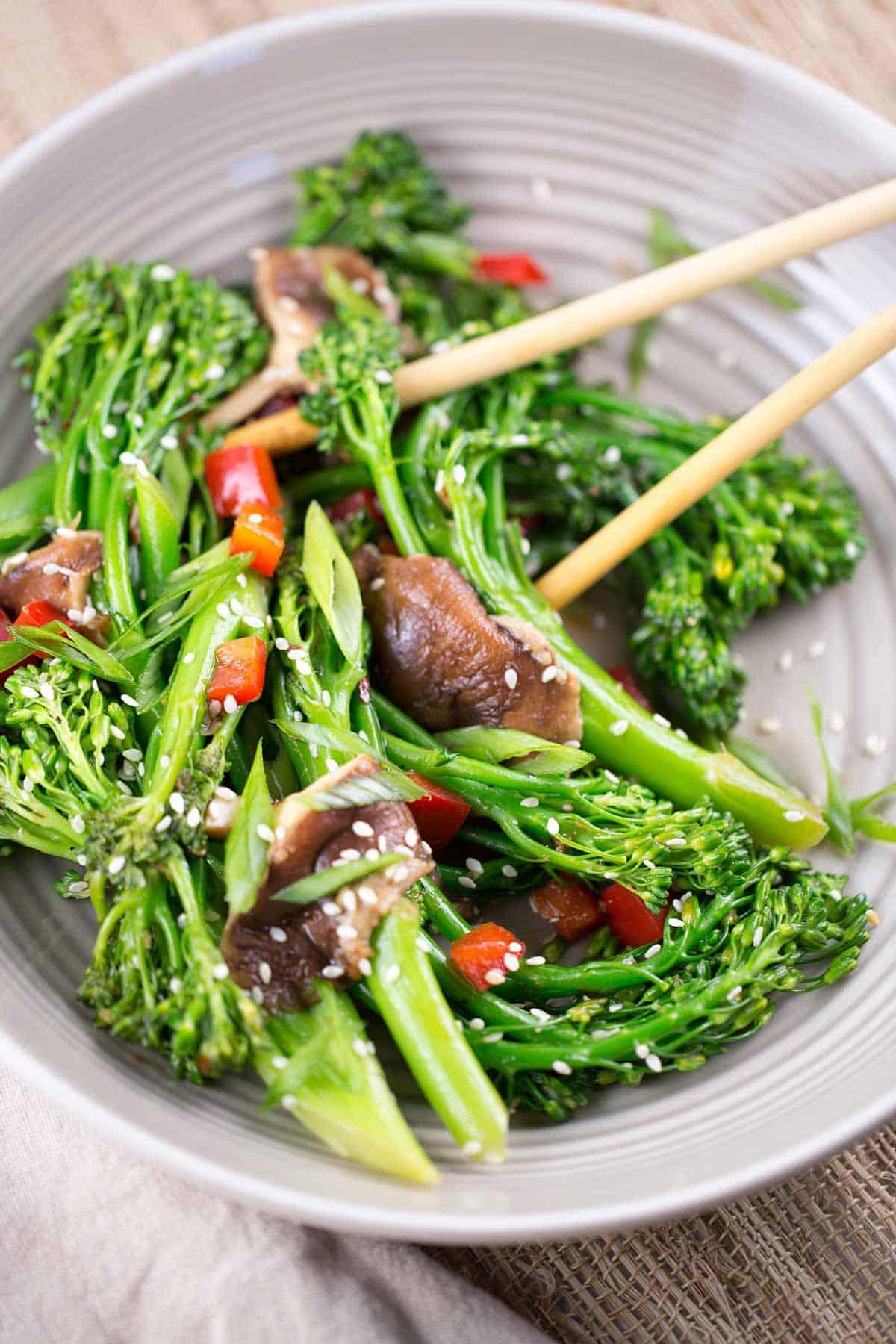 Chinese cuisine of broccolini mushroom sesame stir-fry plate eating chop sticks | jessicagavin.com